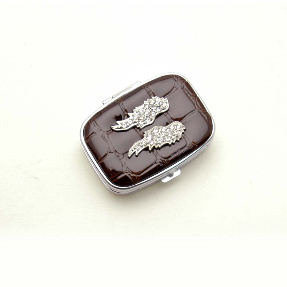 Rhinestone wing accented pill box