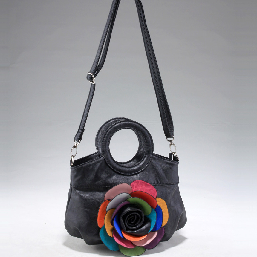 Fashion satchel-style crossbody bag with multi colored floral accent