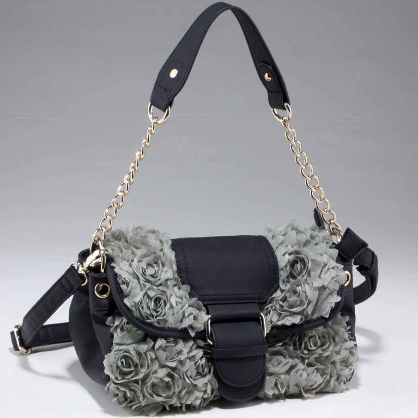 Decorative rosette satchel bag with flap over magnetic snap closure